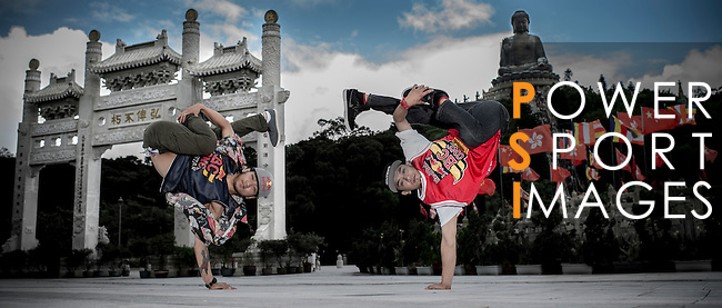 B-Boys Hong 10 of South Korea and Lil Han of Taiwan pose for a portrait at the Po Lin Buddhist monastery in the Hong Kong's Lantau island, ahead the Red Bull BC One Cypher on July 01, 2012. Photo by Victor Fraile / The Power of Sport Images
