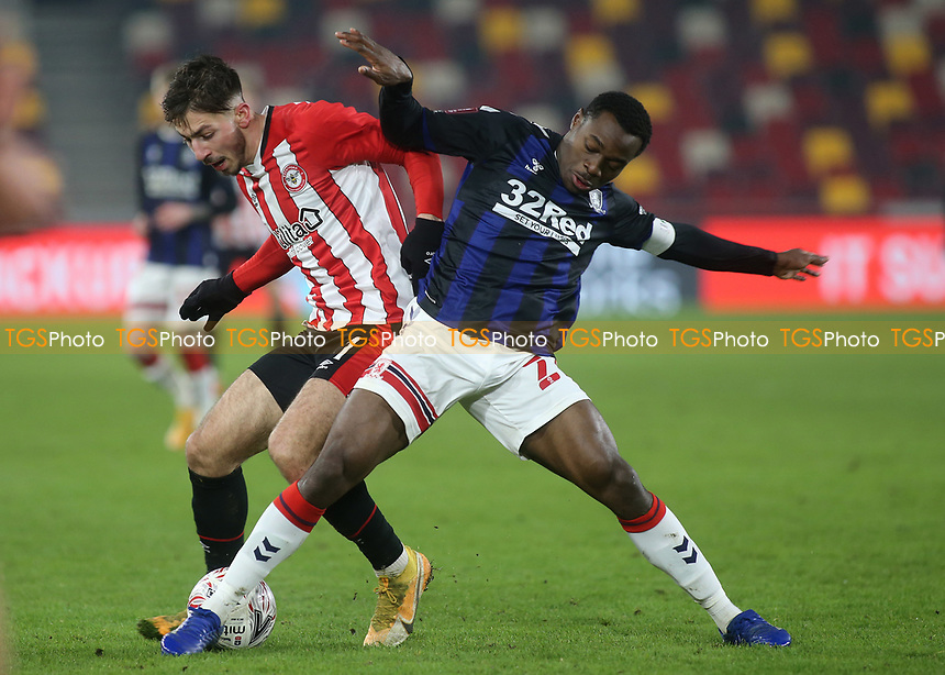 Halil Dervisoglu of Brentford and Middlesbrough's Marc Bola challenge for the ball during Brentford vs Middlesbrough, Emirates FA Cup Football at the Brentford Community Stadium on 9th January 2021