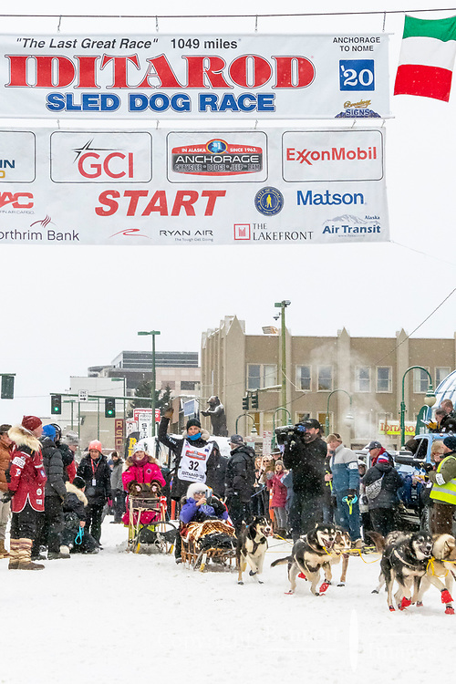 Mille Porsild and team leave the ceremonial start line with an Iditarider and handler at 4th Avenue and D street in downtown Anchorage, Alaska on Saturday March 7th during the 2020 Iditarod race. Photo copyright by Cathy Hart Photography.com