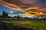 The sunset lights up the sky over Greater Nevada Field in Reno, Nev., on Sunday, July 17, 2016.<br />