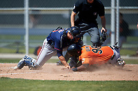 Minnesota Twins catcher A.J. Murray (30) can not come up with the ball as Gerrion Grim (98) slides home during a minor league Spring Training game against the Baltimore Orioles on March 17, 2017 at the Buck O'Neil Baseball Complex in Sarasota, Florida.  (Mike Janes/Four Seam Images)