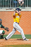 Anthony Massicci (7) of the Canisius Golden Griffins follows through on his swing against the Charlotte 49ers at Hayes Stadium on February 23, 2014 in Charlotte, North Carolina.  The Golden Griffins defeated the 49ers 10-1.  (Brian Westerholt/Four Seam Images)