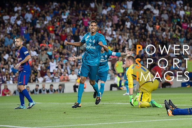 Raphael Varane of Real Madrid (C) celebrating celebrating the opening goal of Real Madrid during the Supercopa de Espana Final 1st Leg match between FC Barcelona and Real Madrid at Camp Nou on August 13, 2017 in Barcelona, Spain. Photo by Marcio Rodrigo Machado / Power Sport Images