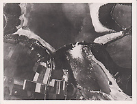 BNPS.co.uk (01202 558833)<br /> Pic: AnthonyCribb/BNPS<br /> <br /> Pictured: An aerial photograph of the damage to the dam.<br /> <br /> Rare navigation sheets which provide a gripping blow-by-blow account of the famous Dambusters raid of World War Two have come to light 78 years on.<br /> <br /> They were filled in by Sergeant Vivian Nicholson who was a navigator on one of the 19 Lancaster bombers involved in Operation Chastise on the night of May 16, 1943.<br /> <br /> As well as jotting down technical information such as wind speeds and directions, Sgt Nicholson used short phrases to offer a 'real-time' commentary of the perilous mission.