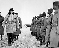General of the Army Douglas MacArthur is shown inspecting troops of the 24th Inf. on his arrival at Kimpo airfield for a tour of the battlefront.  February 21, 1951.  INP.  (USIA)<br /> NARA FILE #:  306-PS-51-10432<br /> WAR & CONFLICT BOOK #:  1375