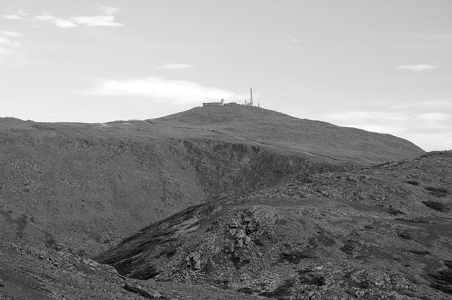 Mt. Washington stands tall above the great gulf, with the track of the cog railway snaking it's way up the summit cone.