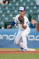 Oklahoma City Dodgers first baseman Zach Walters (4) catches a throw during a game against the Omaha Storm Chasers at Chickasaw Bricktown Ballpark on June 16, 2016 in Oklahoma City, Oklahoma. Oklahoma City defeated Omaha 5-4  (William Purnell/Four Seam Images)