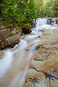 Walker Brook Cascades during the spring months. These cascades are located along Walker Brook in Franconia Notch State Park of the White Mountain National Forest, New Hampshire.