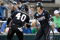 Mississippi State Bulldogs outfielder Jordan Rowdy (4) celebrates after scoring a run during Game 4 of the NCAA College World Series against the Auburn Tigers on June 16, 2019 at TD Ameritrade Park in Omaha, Nebraska. Mississippi State defeated Auburn 5-4. (Andrew Woolley/Four Seam Images)