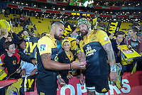 Matt Proctor and Blade Thomson mingle with fans after the Super Rugby match between the Hurricanes and Jaguares at Westpac Stadium, Wellington, New Zealand on Saturday, 9 April 2016. Photo: Dave Lintott / lintottphoto.co.nz