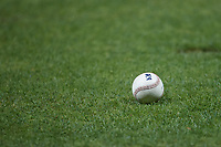 A minor league baseball lies on the grass behind home plate during the game between the Down East Wood Ducks and the Kannapolis Cannon Ballers at Atrium Health Ballpark on May 5, 2021 in Kannapolis, North Carolina. (Brian Westerholt/Four Seam Images)