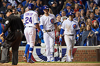 Chicago Cubs Dexter Fowler (24) celebrates with Kris Bryant (center) and Anthony Rizzo (right) after hitting a home run in the eighth inning during Game 4 of the Major League Baseball World Series against the Cleveland Indians on October 29, 2016 at Wrigley Field in Chicago, Illinois.  (Mike Janes/Four Seam Images)