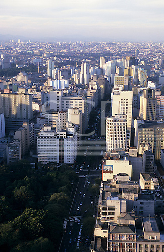 Sao Paulo, Brazil. High view of city centre road with high rise buildings and a small park full of trees.