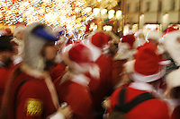 Hundreds of people dressed as Santa Claus cavort in New York City on December 11, 2004 during Santacon, an annual ritual in which a large amount of people dress as St. Nick and wander around NYC en masse to the delight and chagrin of many.