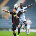 Caley's Gary Warren and Raith Rovers' Christian Nade challenge for the ball.