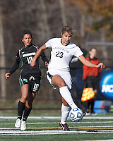 College of St Rose forward Michaela Phillips (23) attempts to control the ball as Wilmington University midfielder Penelope Fantis (10) closes.. In 2012 NCAA Division II Women's Soccer Championship Tournament First Round, College of St Rose (white) defeated Wilmington University (black), 3-0, on Ronald J. Abdow Field at American International College on November 9, 2012.