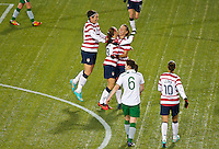 Alex Morgan, Abby Wambach celebrate Morgans first goal of the first half. USWNT played played a friendly against Ireland at JELD-WEN Field in Portland, Oregon on November 28, 2012.