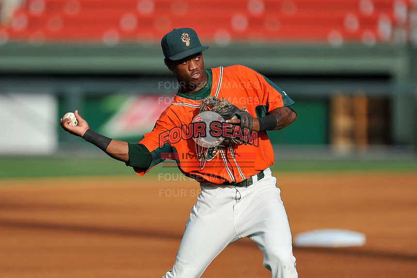 Shortstop Anfernee Seymour (12) of the Greensboro Grasshoppers warms up before a game against the Greenville Drive on Thursday, July 14, 2016, at Fluor Field at the West End in Greenville, South Carolina. (Tom Priddy/Four Seam Images)
