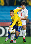Luis Fabiano of Brazil vs Ismael Fuentes of Chile  during the 2010 FIFA World Cup South Africa. EXPA Pictures © 2010, PhotoCredit: EXPA/ Sportida/ Vid Ponikvar +++ Slovenia OUT +++