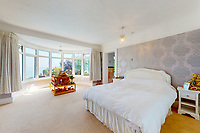 BNPS.co.uk (01202 558833)<br /> Pic: Savills/BNPS<br /> <br /> Pictured: One of the bedrooms.<br /> <br /> A clifftop home with breathtaking panoramic sea views is on the market for £3.25m.<br /> <br /> Sandpierre also has a private swimming pool and a viewing platform overlooking the beach with 180-degree views of the water. <br /> <br /> The six-bedroom family home is on the Bournemouth/Poole coastline in Dorset and is being sold for the first time in 25 years.<br /> <br /> The house was built in the 1930s and is in a quiet cul-de-sac in Branksome Dene Chine - midway between the town centres of Bournemouth and Poole.