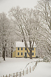 Classic new england federal style home with snow coating.