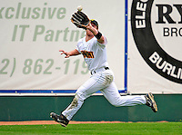 30 April 2009: University of Vermont Catamounts' outfielder Justin Milo, a Junior from Edina, MN, pulls in an outfield fly during a game against the Siena College Saints at Historic Centennial Field in Burlington, Vermont. The Saints outscored the Catamounts 11-10 in the afternoon matchup. The Catamounts are playing their last season of baseball, as the program has been marked for elimination due to budgetary constraints at the University. Mandatory Photo Credit: Ed Wolfstein Photo