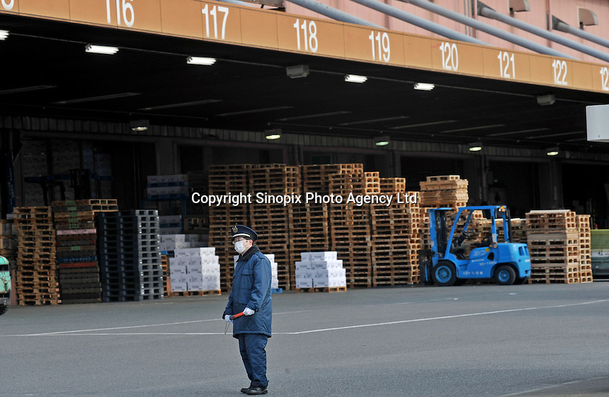A commander at the Port of Tokyo in Japan, stands in front of empty cargo storage and fork-lifts. Industrial production in Japan plunged at the steepest pace in 55 years in the fourth quarter, and unemployment rose at the fastest rate in 41 years with exports in the third quarter were a record 13.9 per cent lower than in the previous quarter..19 Feb 2009