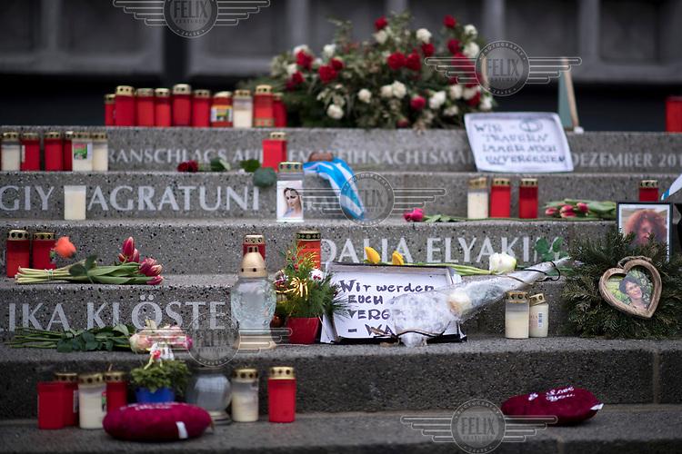 Candles left on a memorial for the 19 December Breitscheidplatz Christmas market terror attack.