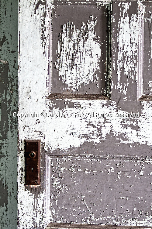 Deteriorating doors are in an old, historic building near Kansas City, Missouri.