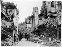 Canadian official photographs<br /> Description<br /> <br /> Gen. Sir Sam Hughes and party inspects the ruins brought about by the German shell fire