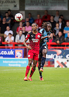 Marcus Bean of Wycombe Wanderers  clears from the oncoming Lewis Young of Crawley Town during the Sky Bet League 2 match between Crawley Town and Wycombe Wanderers at Checkatrade.com Stadium, Crawley, England on 29 August 2015. Photo by Liam McAvoy.