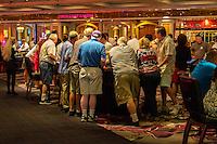 Las Vegas, Nevada.  Flamingo Casino.  Patrons at Gaming Tables.