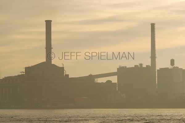 Industrial Scene-Electric Power Plant and Smokestacks in the Vinegar Hill Neighborhood of Brooklyn, East River in the foreground....Brooklyn, New York City, New York State, USA