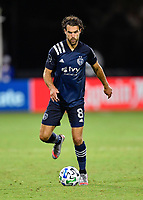 LAKE BUENA VISTA, FL - JULY 26: Graham Zusi of Sporting KC dribbles the ball during a game between Vancouver Whitecaps and Sporting Kansas City at ESPN Wide World of Sports on July 26, 2020 in Lake Buena Vista, Florida.