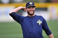 Tucker Tharp (5) of the Columbia Fireflies warms up before a game against the Greenville Drive on Thursday, April 21, 2016, at Fluor Field at the West End in Greenville, South Carolina. Columbia won, 13-9. (Tom Priddy/Four Seam Images)