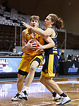 SIOUX FALLS, SD - MARCH 7: Rocky Kreuser #34 of the North Dakota State Bison drives on Josiah Allick #20 of the UMKC Kangaroos during the Summit League Basketball Tournament at the Sanford Pentagon in Sioux Falls, SD. (Photo by Richard Carlson/Inertia)