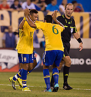 Neymar (11) of Brazil celebrates his goal with teammate Andre Santos (6) during an international friendly at the New Meadowlands Stadium in East Rutherford, NJ. Brazil defeated the USMNT, 2-0.