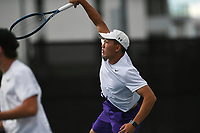 Fayetteville's David Zhu hits, Monday, October 11, 2021 during the 6A state girls and boys tennis tournament at Memorial Park in Bentonville. Check out nwaonline.com/211012Daily/ for today's photo gallery. <br /> (NWA Democrat-Gazette/Charlie Kaijo)