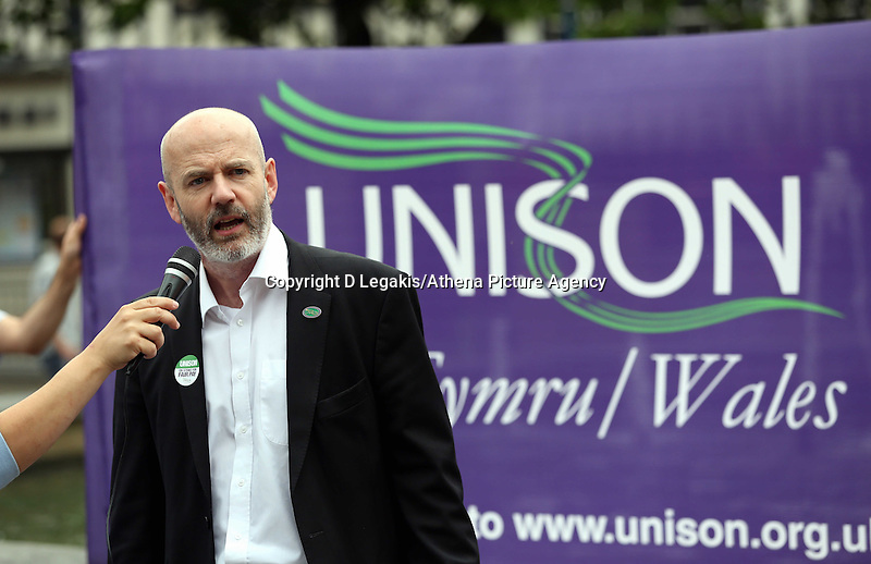 Swansea, UK. Thursday 10 July 2014<br /> Pictured: Dominic MacAskill of Unison speaking at Castle Square Gardens, Swansea, south Wales.<br /> Re: Strikes are taking place across the UK in a series of disputes with the government over pay, pensions and cuts, with more than a million public sector workers expected to join the action.<br /> Firefighters, librarians and council staff are among those taking part from several trade unions, with rallies taking place across the UK.
