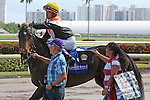 HALLANDALE BEACH, FL - JANUARY 21:  #3 Family Meeting(FL) with jockey Jose A Lezcano on board, heads to the winners' circle, after winning the Sunshine Millions Filly & Mare Turf at Gulfstream Park on January 21, 2017 in Hallandale Beach, Florida. (Photo by Liz Lamont/Eclipse Sportswire/Getty Images)