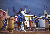 African Pavillion, 1964 World's Fair, Flushing Meadows, New York. A troupe of seven foot tall Watusi warriors and a dozen drummers, the personal performers of King Mwambutsa of Burundi, dance a victory celebration. Photo by John G. Zimmerman.