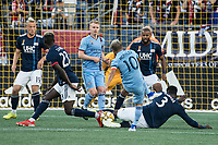 FOXBOROUGH, MA - SEPTEMBER 29: Jalil Anibaba #3 of New England Revolution slides to intercept a kick on goal from Maximiliano Moralez #10 of New York City FC during a game between New York City FC and New England Revolution at Gillettes Stadium on September 29, 2019 in Foxborough, Massachusetts.
