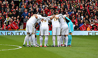 Pictured: Swansea players huddle before kick off.<br /> Sunday 12 May 2013<br /> Re: Barclay's Premier League, Manchester City FC v Swansea City FC at the Old Trafford Stadium, Manchester.