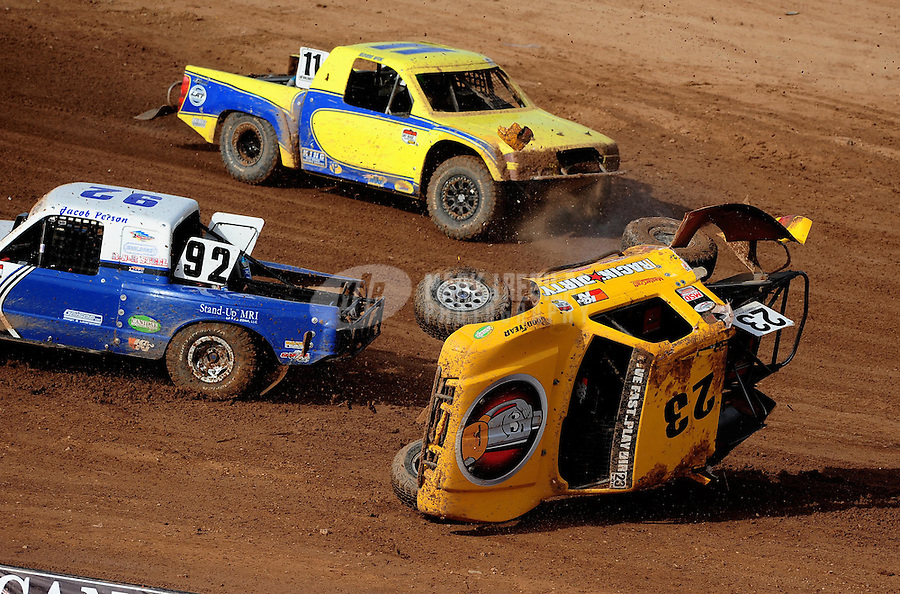 Apr 17, 2010; Surprise, AZ USA; LOORRS pro light unlimited driver Jerry Daugherty (23) flips over after contact with Jacob Person (92) over a jump during round 3 at Speedworld Off Road Park. Mandatory Credit: Mark J. Rebilas-US PRESSWIRE.