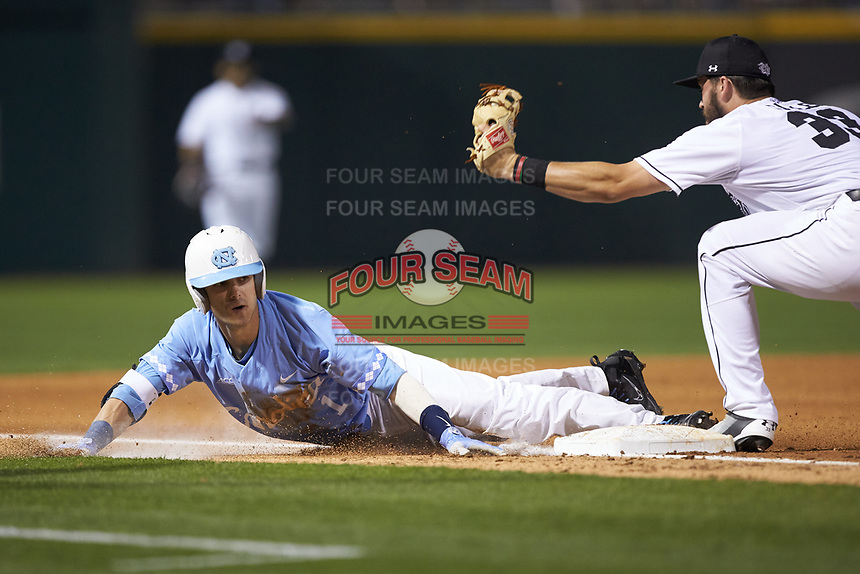 Brandon Riley (1) of the North Carolina Tar Heels slides into third base against Chris Cullen (33) of the South Carolina Gamecocks at BB&T BallPark on April 3, 2018 in Charlotte, North Carolina. The Tar Heels defeated the Gamecocks 11-3. (Brian Westerholt/Four Seam Images)