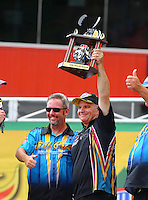 Jun 21, 2015; Bristol, TN, USA; NHRA funny car driver Tim Wilkerson celebrates as he receiving The Shirl Greer Old Champs Choice Award during the Thunder Valley Nationals at Bristol Dragway. Mandatory Credit: Mark J. Rebilas-