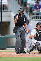 Home plate umpire Paul Clemons makes a strike call during the International League game between the Syracuse Chiefs and the Charlotte Knights at BB&T BallPark on June 1, 2016 in Charlotte, North Carolina.  The Knights defeated the Chiefs 5-3.  (Brian Westerholt/Four Seam Images)