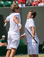 England, London, 28.06.2014. Tennis, Wimbledon, AELTC, Gentlemen's invitational doubles, Paul Haarhuis (NED) and his partner Jacco Eltingh (NED) (R) doing a breast bump<br /> Photo: Tennisimages/Henk Koster