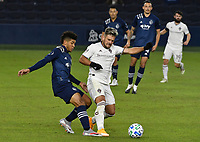 KANSAS CITY, KS - OCTOBER 24: #26 Jaylin Lindsey of Sporting Kansas City and #11 Diego Rubio of the Colorado Rapids battle for the ball in midfield during a game between Colorado Rapids and Sporting Kansas City at Children's Mercy Park on October 24, 2020 in Kansas City, Kansas.