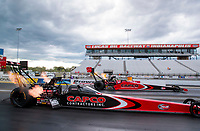 Jul 11, 2020; Clermont, Indiana, USA; NHRA top fuel driver Billy Torrence (near) races alongside son Steve Torrence during qualifying for the E3 Spark Plugs Nationals at Lucas Oil Raceway. This is the first race back for NHRA since the start of the COVID-19 global pandemic. Mandatory Credit: Mark J. Rebilas-USA TODAY Sports
